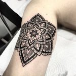 Black mandala on the right bicep