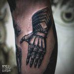 Black medieval gauntlet tattoo