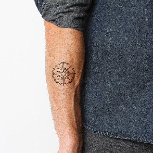 Black minimal compass tattoo
