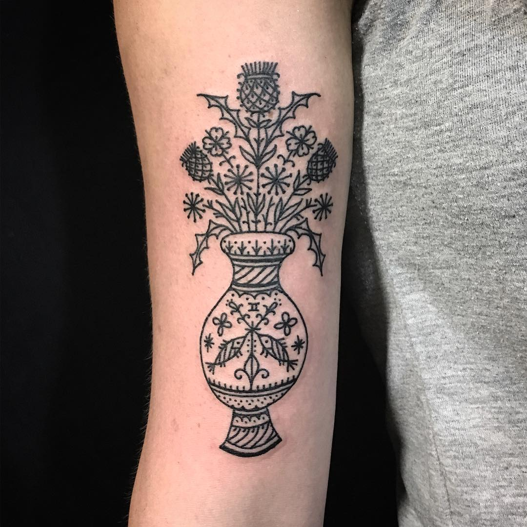 Black ornamental vase with flowers tattoo