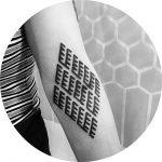 Black rhombus shaped ornament tattoo