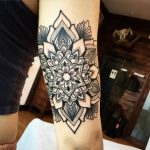 Black simple mandala on the arm