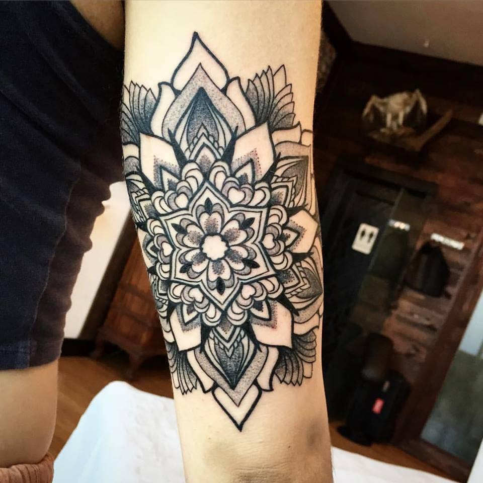 Black simple mandala on the arm