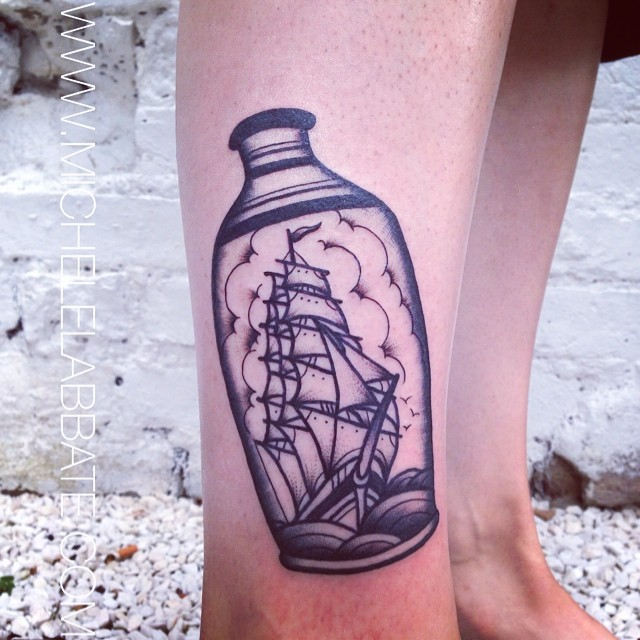 Black tattoo of a ship in a vase