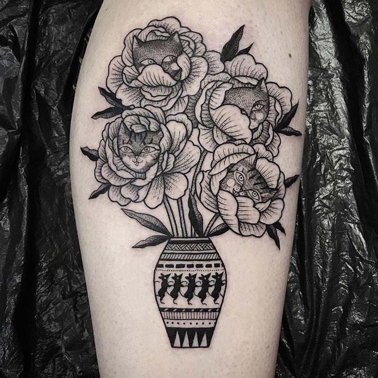 Black vase and flowers tattoo