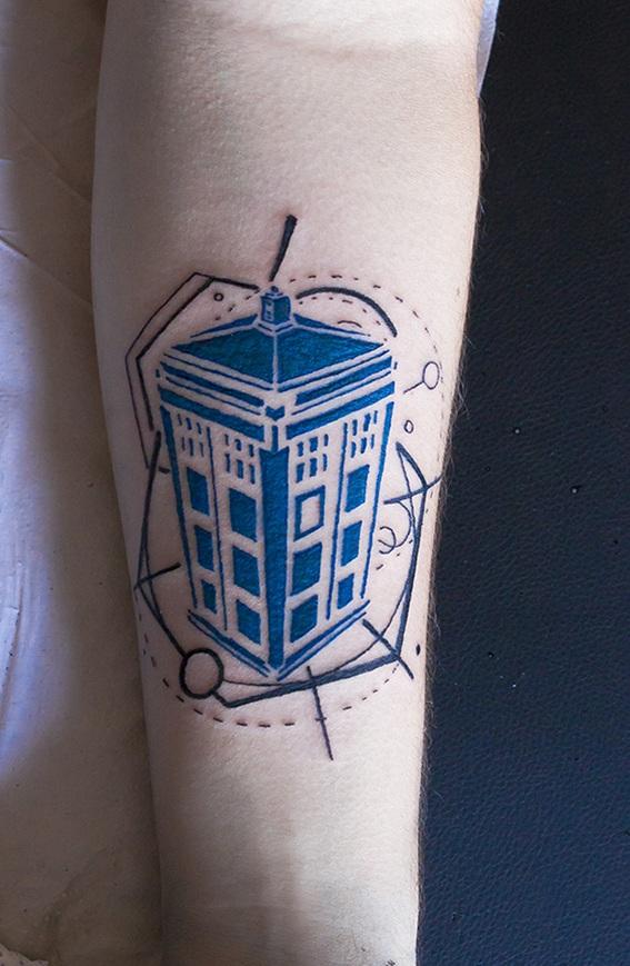 Blue building tattoo