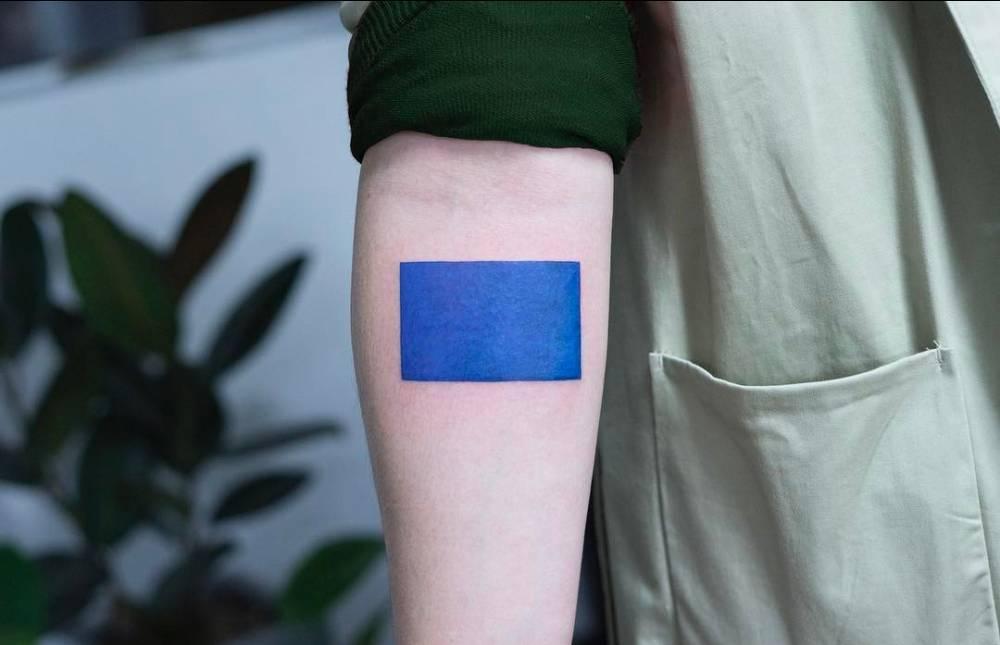 Blue rectangle tattoo