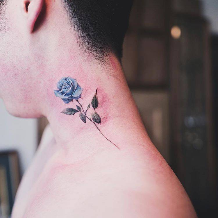 Blue rose tattoo on the neck - Tattoogrid.net
