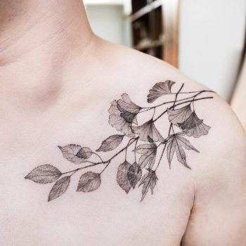 Branch with leaves tattoo on the shoulder