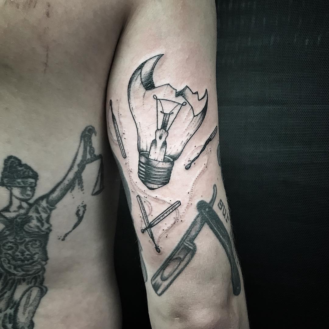 Broken lightbulb tattoo
