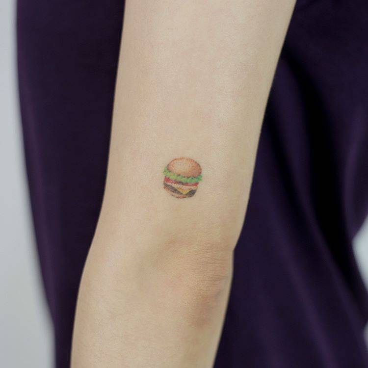 Burger tattoo on the arm