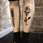 Butterfly knife and black rose tattoos