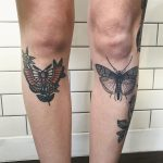 Butterfly tattoos on both shins