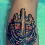 Cactus and horseshoe tattoo
