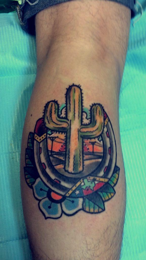 Cactus and horseshoe tattoo