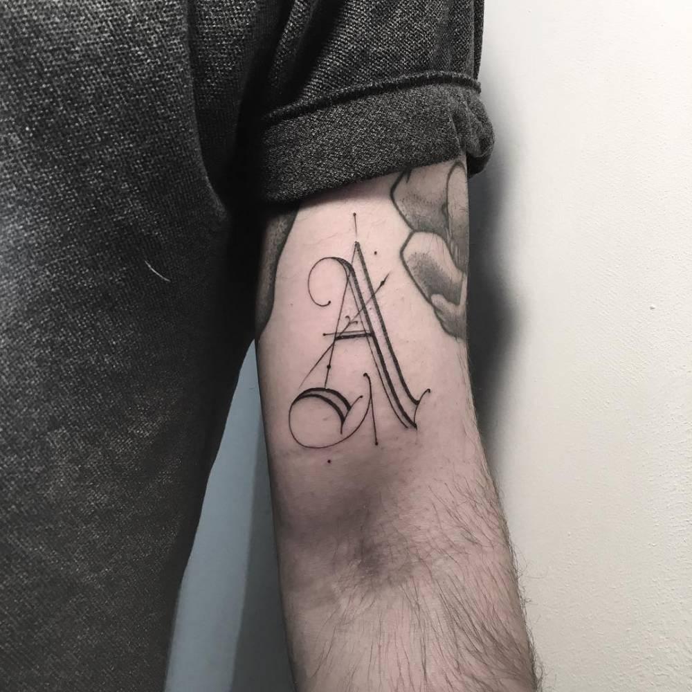 Caligraphy tattoo