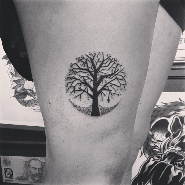 Circular black tree tattoo