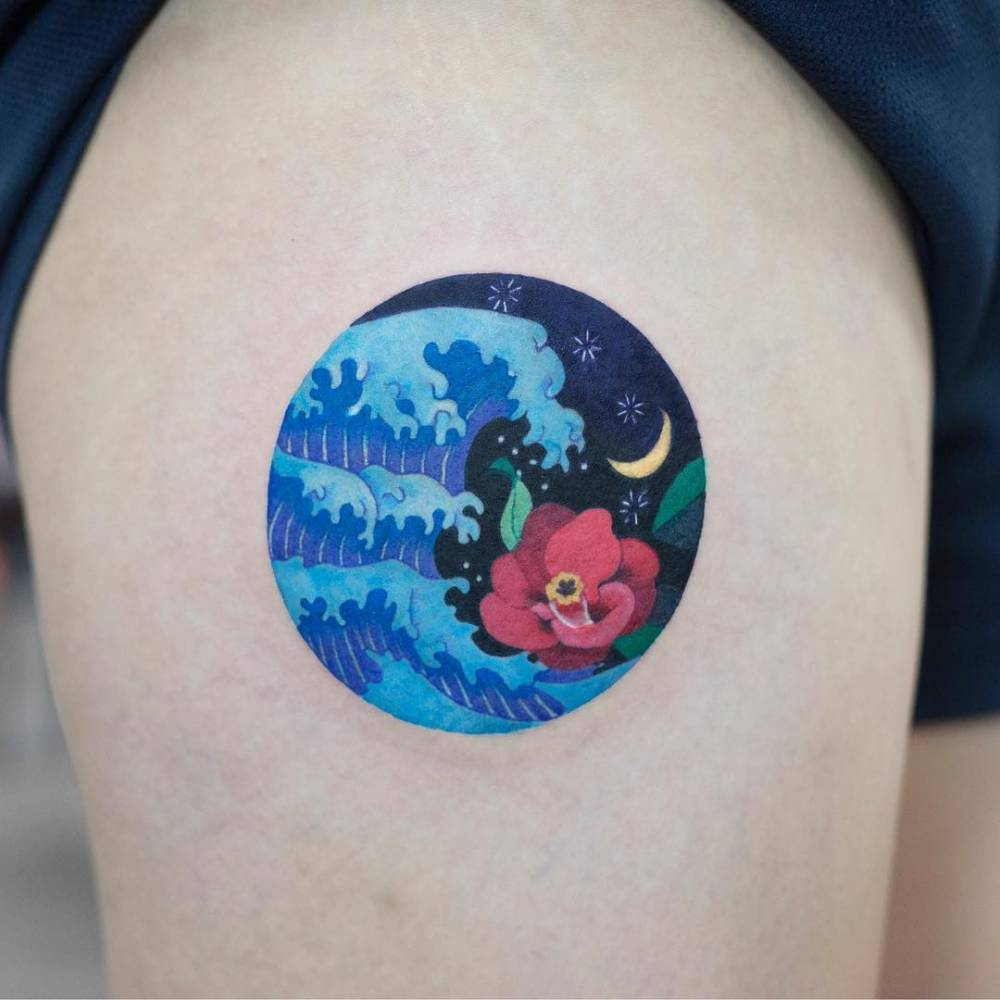 Circular colorful wave tattoo on the thigh