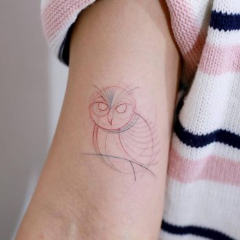 Circular owl tattoo