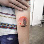 Circular sunset landscape tattoo