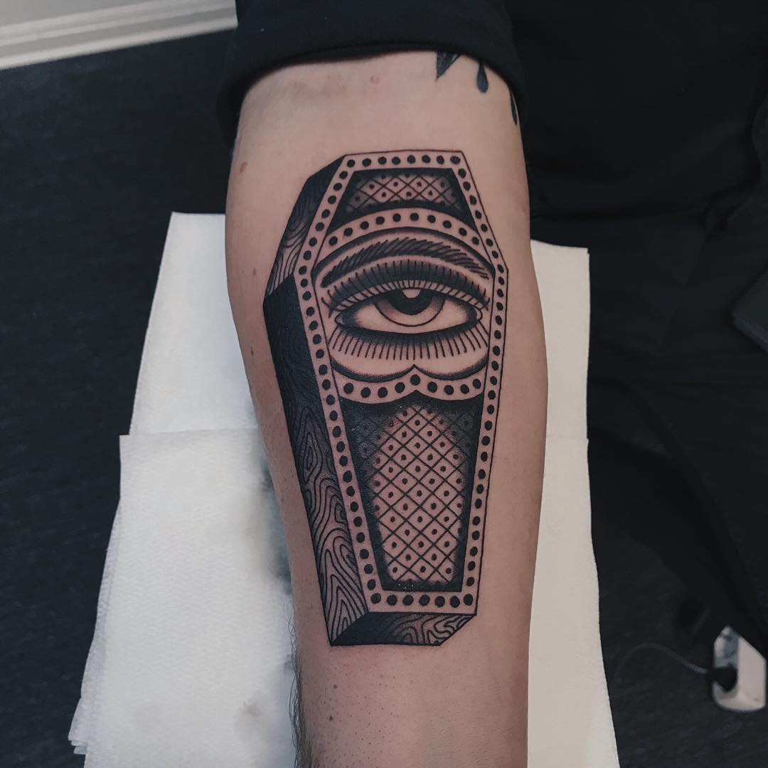 Coffin with an eye tattoo