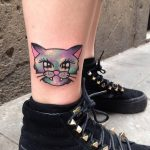 Colorful cat head tattoo