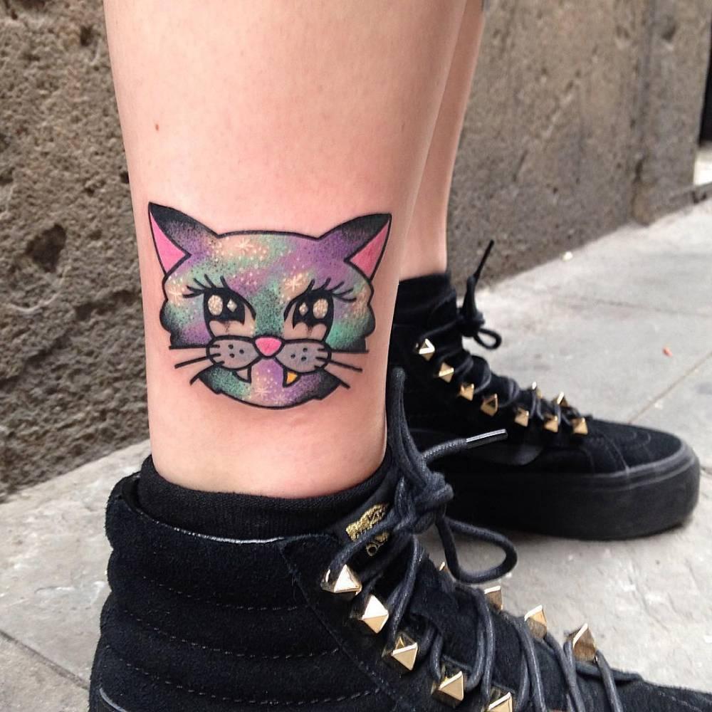 Colorful cat head tattoo