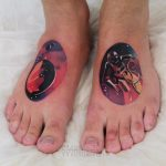Colorful cosmic tattoos on both feet
