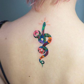 Colorful floral snake tattoo on the back