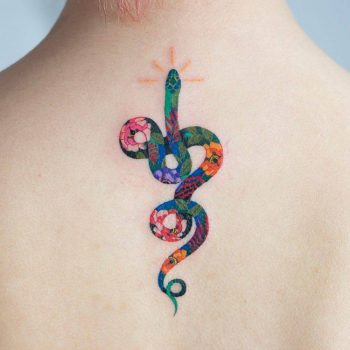 Colorful floral snake tattoo on the upper back