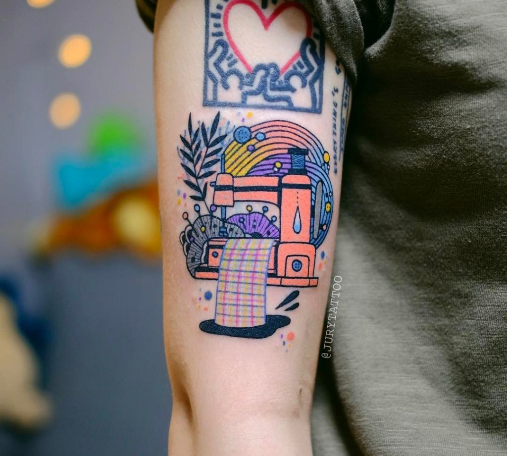 Colorful sewing machine tattoo