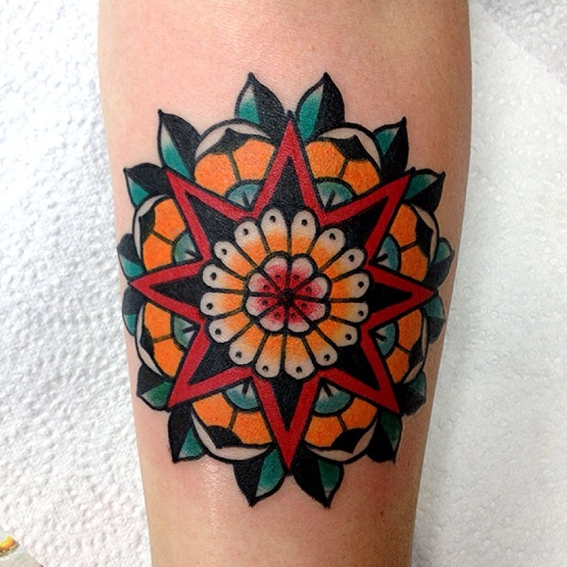 Colorful star and mandala tattoo
