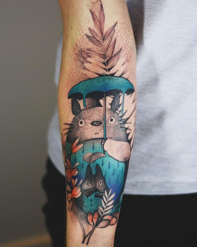 Colorful totoro tattoo on the inner forearm