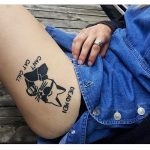 Cool cat tattoo on the left hip