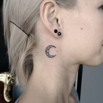 Crescent moon tattoo on the neck