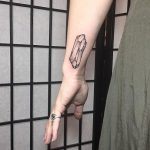 Crystal stone tattoo on the wrist