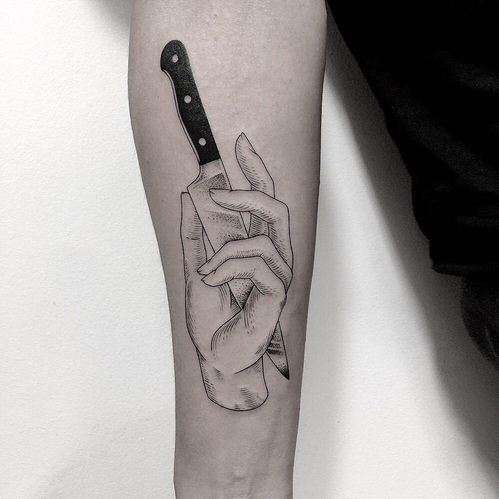 Cut hand tattoo