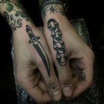 Dagger and chain tattoos