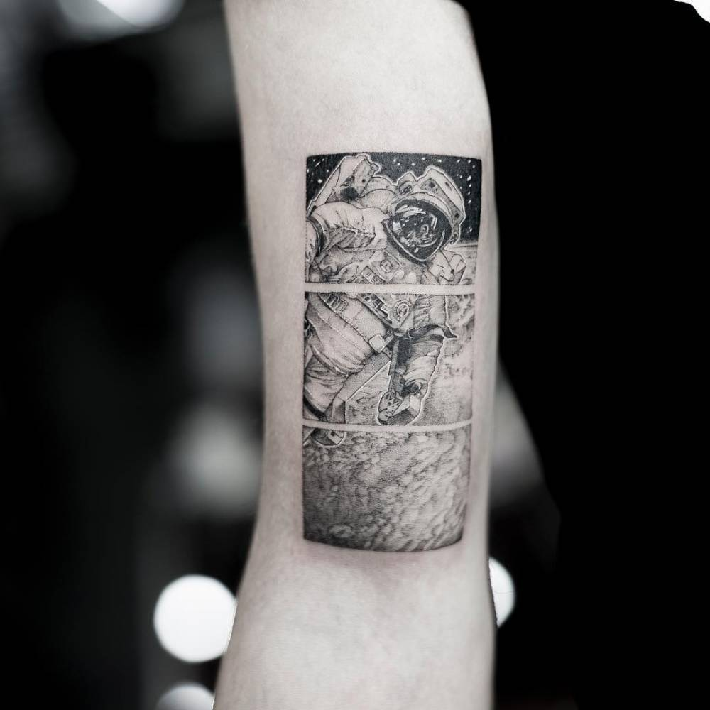 Detailed black and gray astronaut tattoo