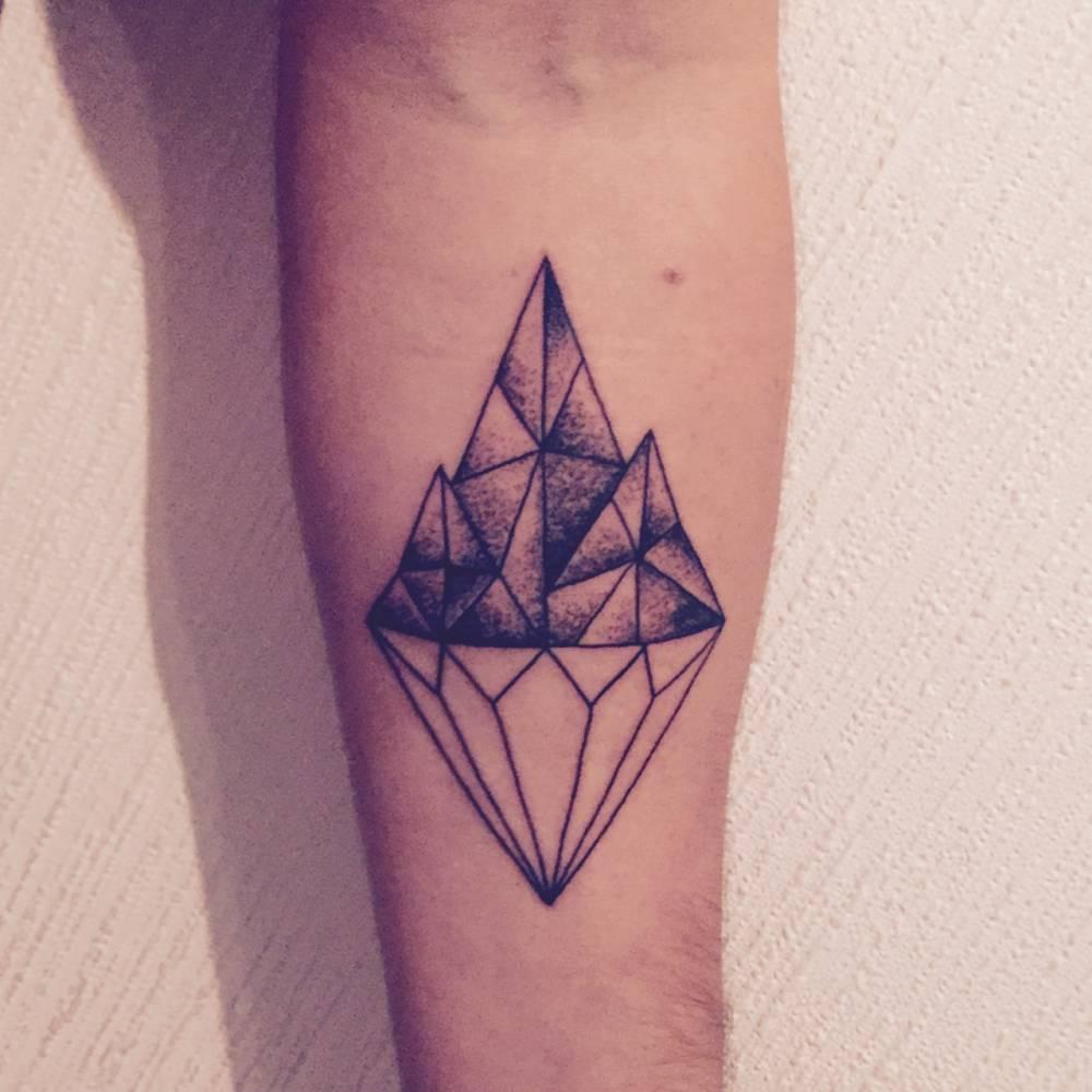 Diamond and mountain tattoo