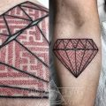 Diamond with a geometric pattern tattoo