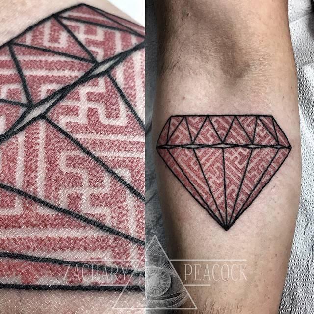 Diamond with a geometric pattern tattoo