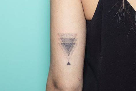 Disappearing gradient triangle tattoo