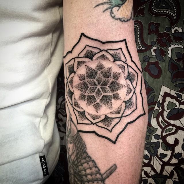 Dotwork black mandala on the inner forearm