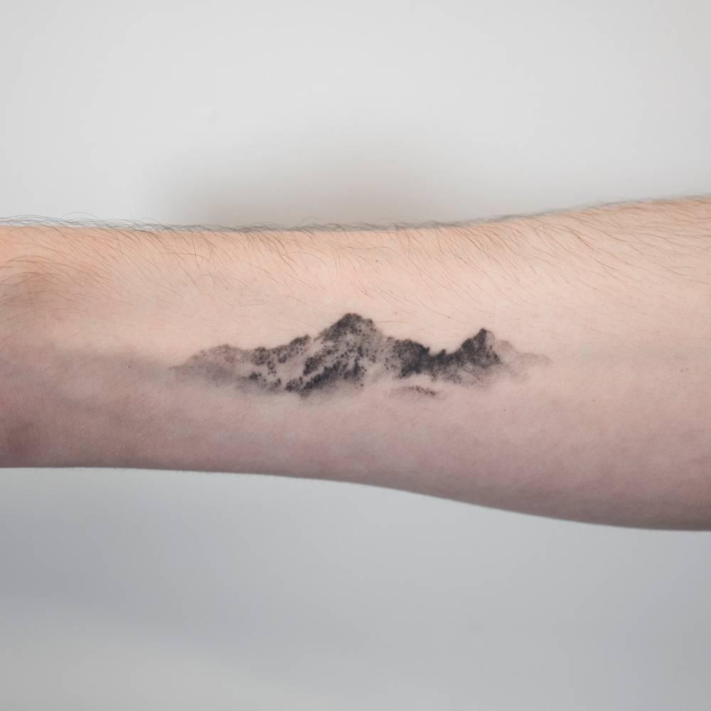 Dotwork mountains tattoo