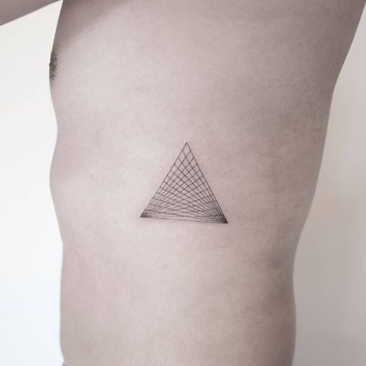 Dotwork style triangle tattoo on the rib cage