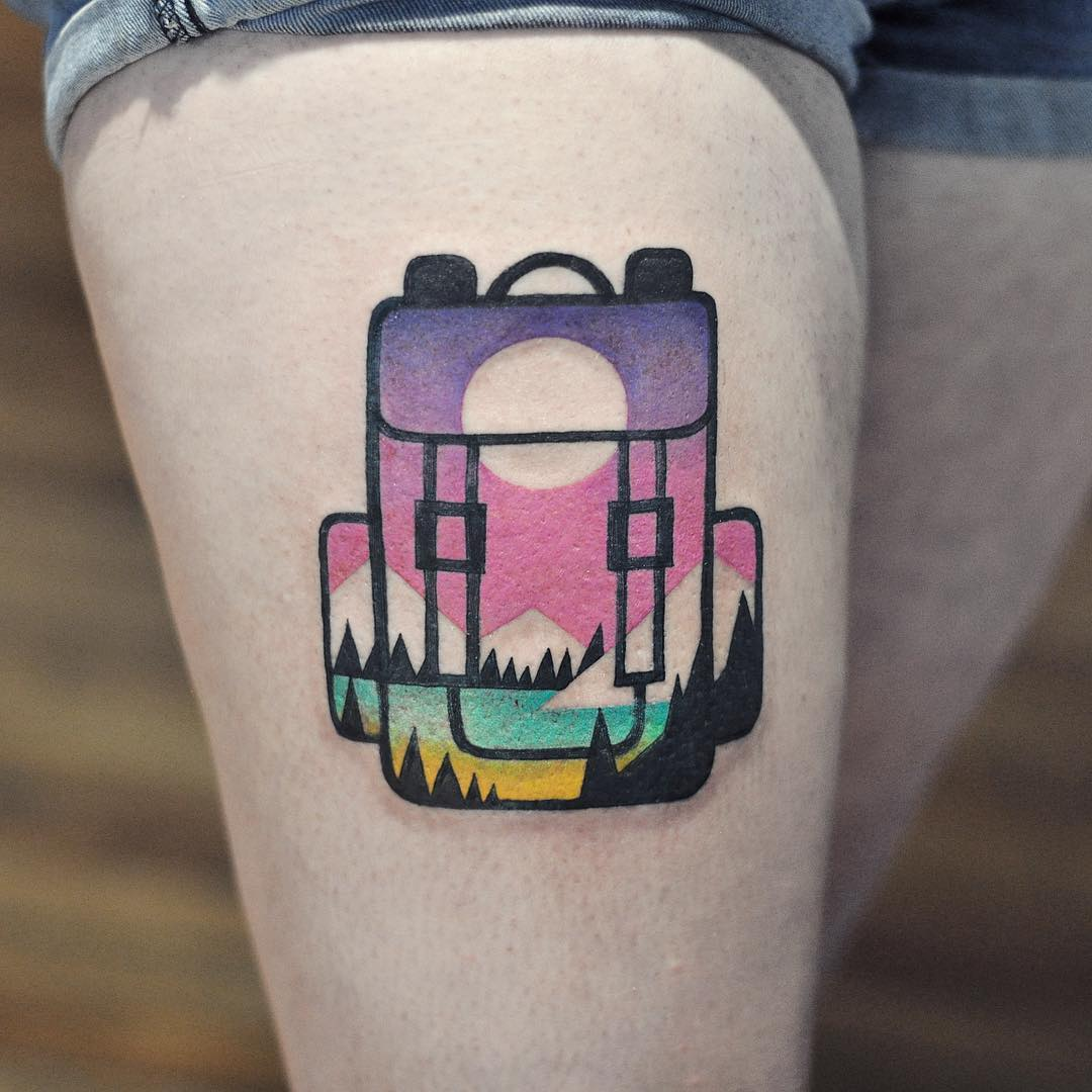 Double exposure backpack and landscape tattoo