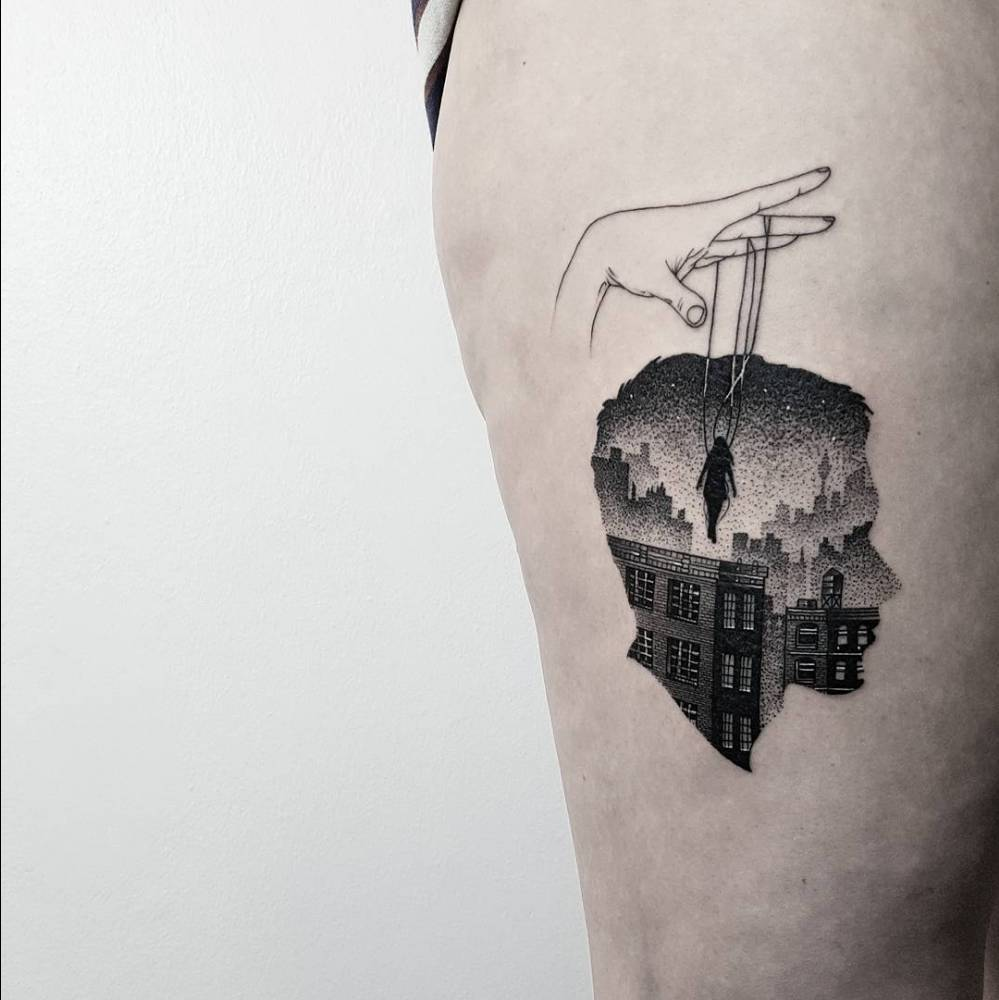 Double exposure head and city tattoo