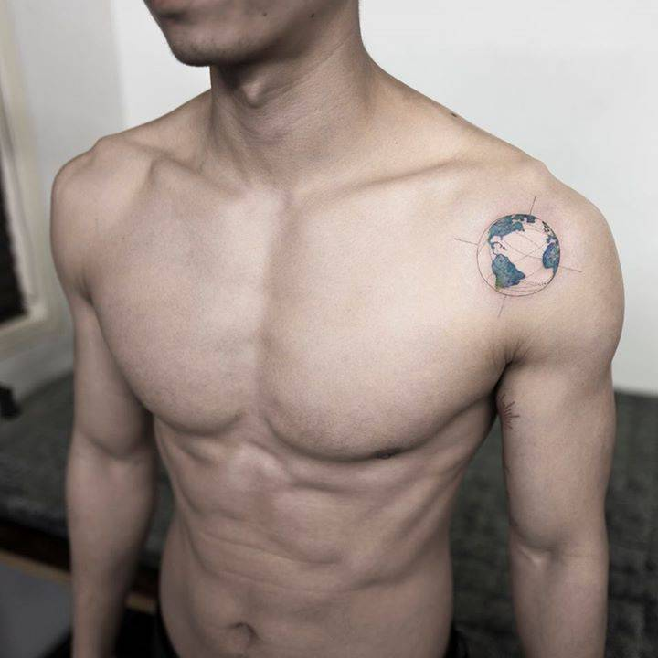 Earth tattoo on the left shoulder