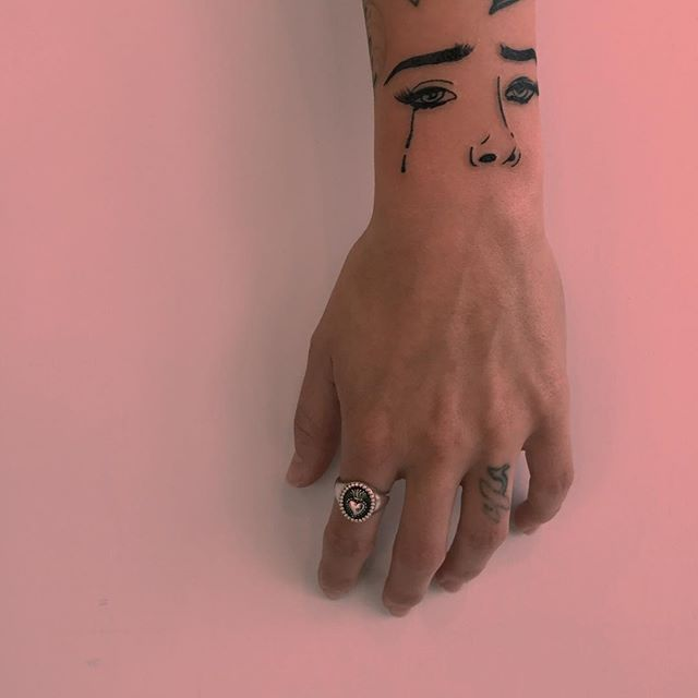Eyes and nose tattoo
